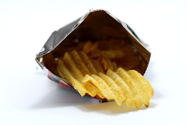aerosol cans on a plane - potato chip bag