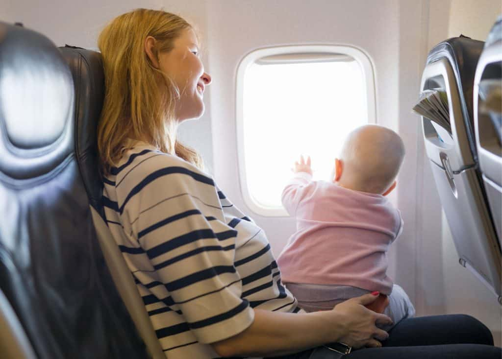 Flying with kids - baby sitting on lap